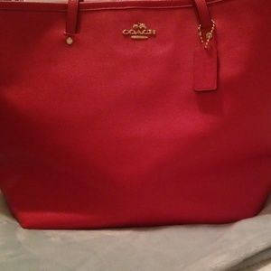 Brand new red leather Caoch bag.